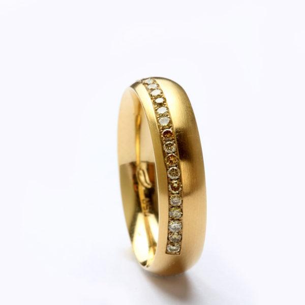 Memoire-Ring in Gold mit Diamanten